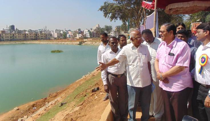 Sri. N Santosh Hegde looking at the developments near the  lake