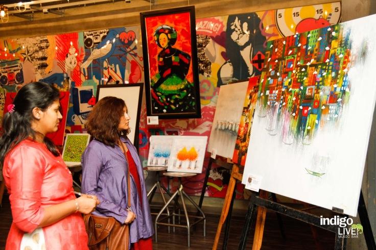 Art lovers examine the intircate details at Indigo Live Music Bar