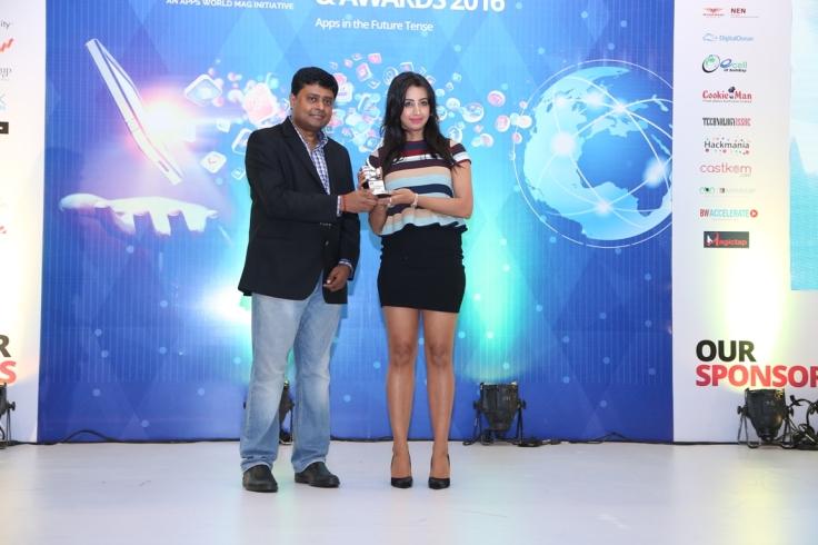 L-R C R Venkatesh, GMASA Chairman handing over award to Sanjana Galrani