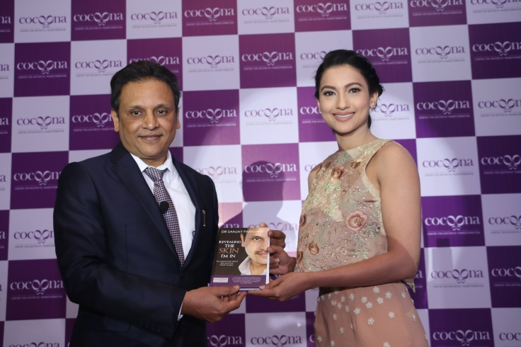 Dr. Sanjay Parashar presenting his book to Gauahar Khan during the brand launch here in Delhi today