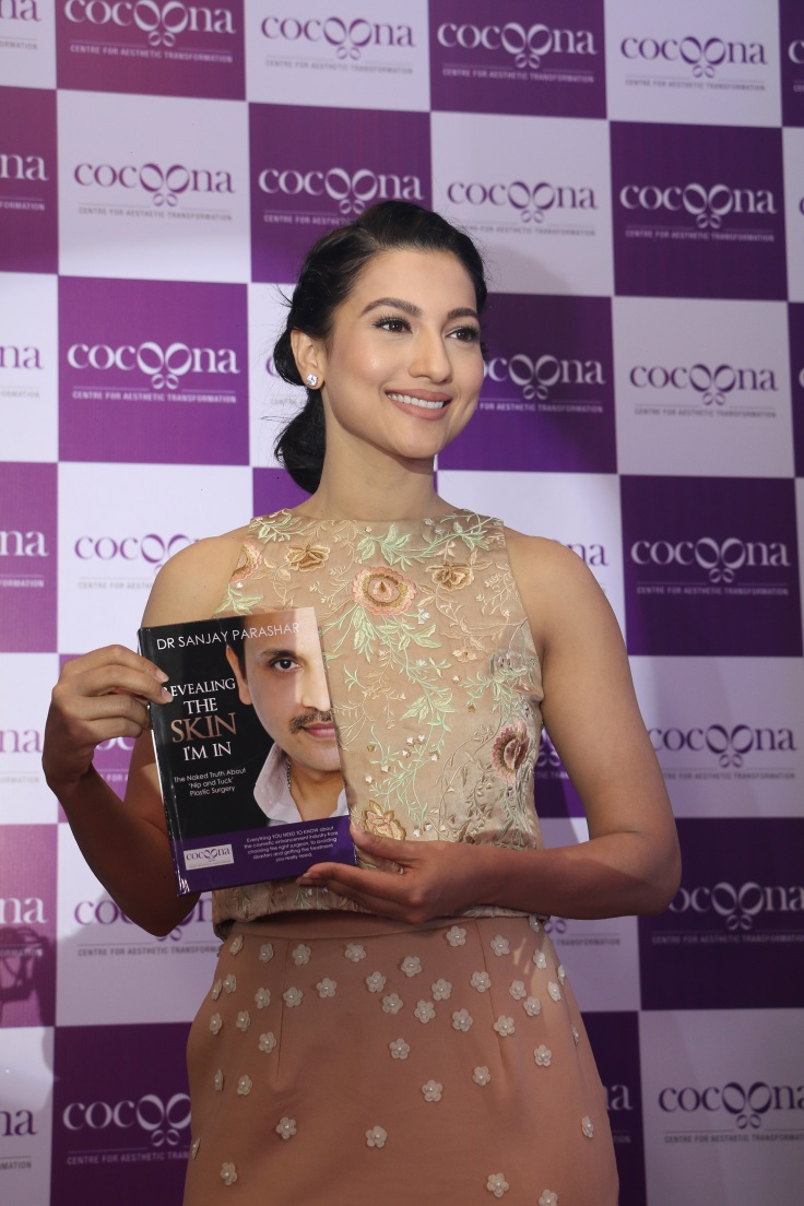 Gauahar Khan with Dr. Sanjay Parashar's book Revealing the Skin I am In